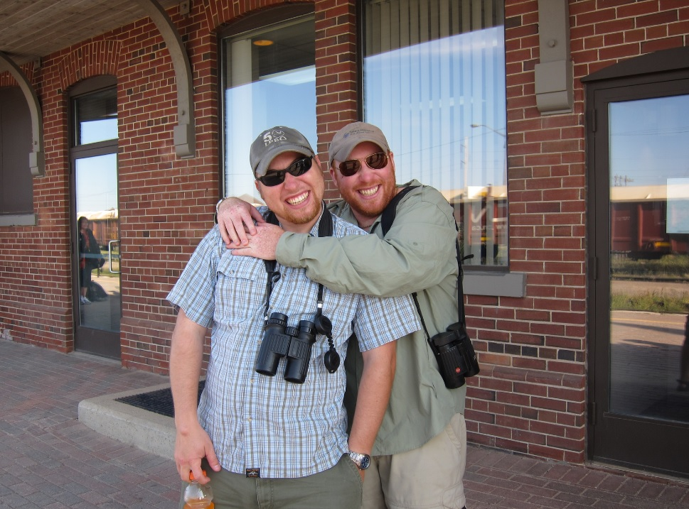 """Brotherly love. Mike (left) and Ken (right) waiting to board the """"Polar Bear Express"""" from Cochrane to Moosonee. Photo by Barb Charlton."""
